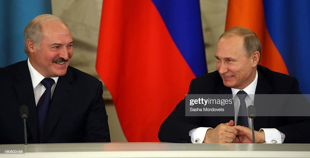 Russian President <a gi-track='captionPersonalityLinkClicked' href=/galleries/search?phrase=Vladimir+Putin&family=editorial&specificpeople=154896 ng-click='$event.stopPropagation()'>Vladimir Putin</a> speaks to Belarussian President <a gi-track='captionPersonalityLinkClicked' href=/galleries/search?phrase=Alexander+Lukashenko&family=editorial&specificpeople=542572 ng-click='$event.stopPropagation()'>Alexander Lukashenko</a> in the Grand Kremlin Palace, on December 23, 2014 in Moscow, Russia. Leaders of Russia, Belarus, Kazakhstan, Kyrgyzstan and Tajikistan have arrived to Moscow to take part in the Summit of Collective Security Treaty Organisation (CSTO) and in the Summit of Eurasian Economic Cooperation Union.