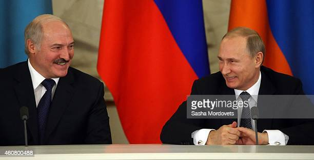 Russian President Vladimir Putin speaks to Belarussian President Alexander Lukashenko in the Grand Kremlin Palace on December 23 2014 in Moscow...