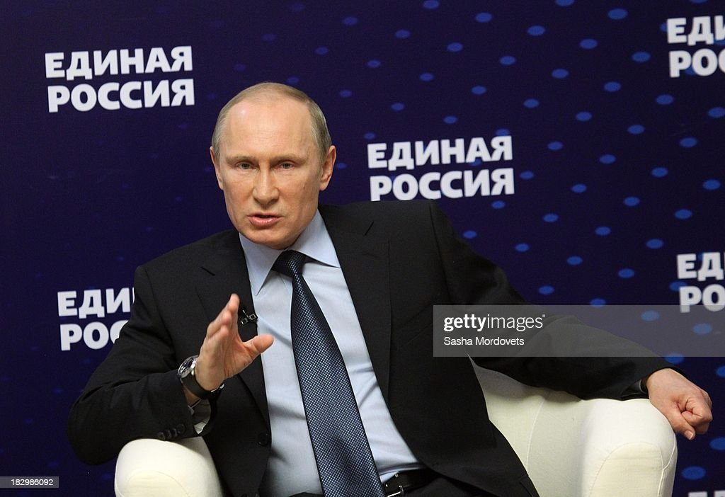 Russian President <a gi-track='captionPersonalityLinkClicked' href=/galleries/search?phrase=Vladimir+Putin&family=editorial&specificpeople=154896 ng-click='$event.stopPropagation()'>Vladimir Putin</a> speaks with activists of the ruling party United Russia on October 3, 2013 in Moscow, Russia. Putin meets the heads of grassroot organizations of the ruling United Russia party as part of the United Russia party congress.
