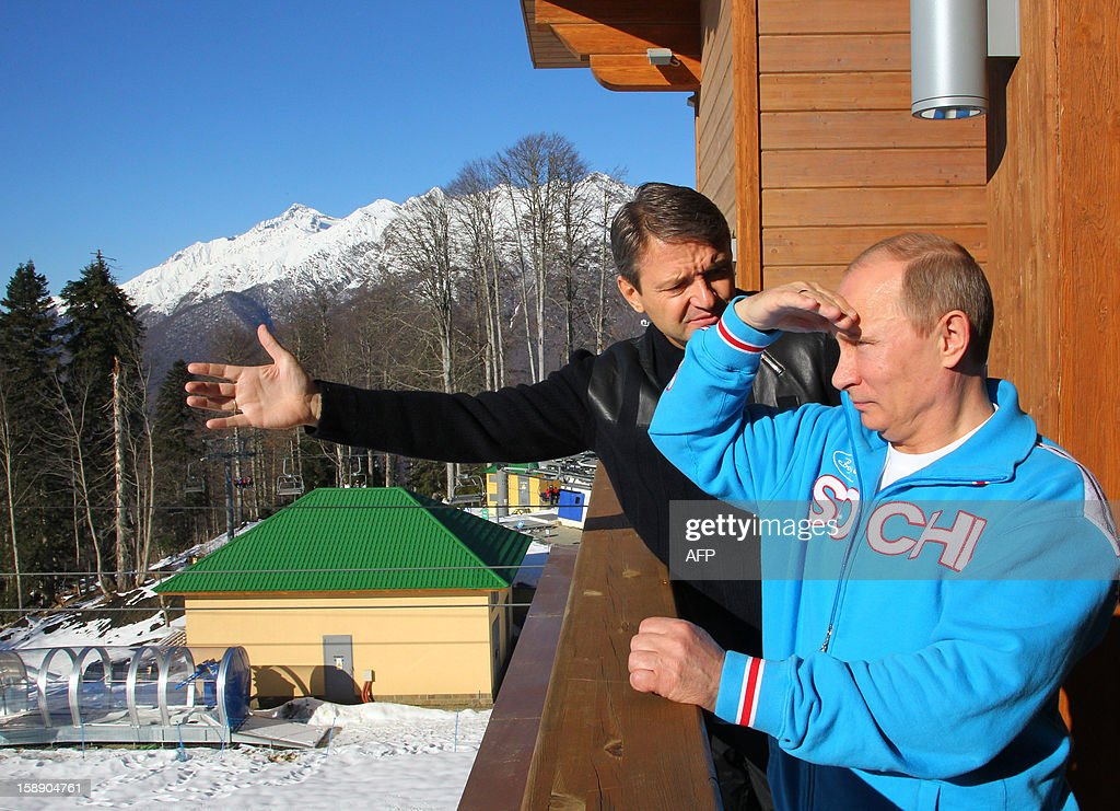 Russian President Vladimir Putin (R) speaks with Alexander Tkachev (L), Krasnodar region Governor, during a visit to the mountain resort in Krasnaya Polyana outside the Russian Black Sea resort of Sochi on January 3, 2013.