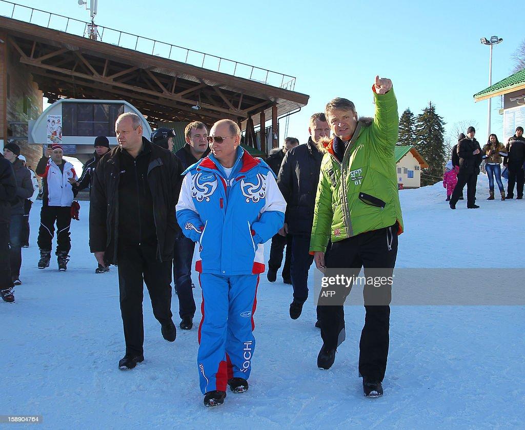 Russian President Vladimir Putin (L) speaks with Alexander Tkachev (R), Krasnodar region Governor during a visit to the mountain resort in Krasnaya Polyana outside the Russian Black Sea resort of Sochi on January 3, 2013.