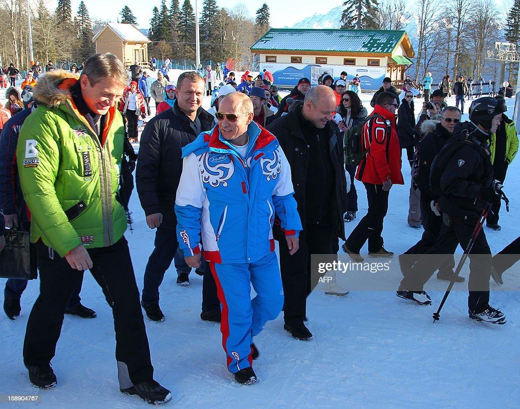Russian President Vladimir Putin (C) speaks with Alexander Tkachev (L), Krasnodar region Governor during a visit to the mountain resort in Krasnaya Polyana outside the Russian Black Sea resort of Sochi on January 3, 2013.