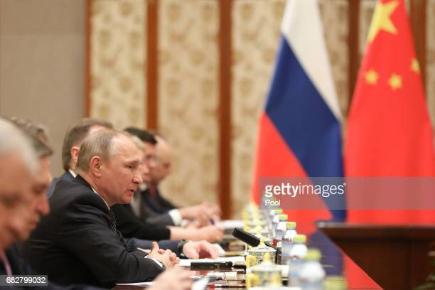 Russian President Vladimir Putin speaks with Chinese President Xi Jinping during a bilateral meeting at Diaoyutai State Guesthouse in Beijing China...