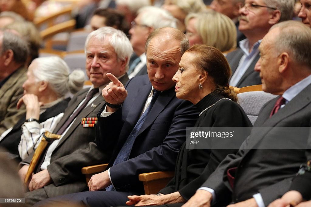 Russian President Vladimir Putin (3rd R) speaks with famous former ballerina Maya Plisetskaya (2nd R) during the Grand gala dedicated to the opening of the new stage Mariinsky II theatre in St. Petersburg on May 2, 2013. Russia's famous Mariinsky theatre in Saint Petersburg was to inaugurate a new ballet and opera house on May 2 in an event coinciding with the 60th birthday of its hugely ambitious and well-connected director Valery Gergiev.