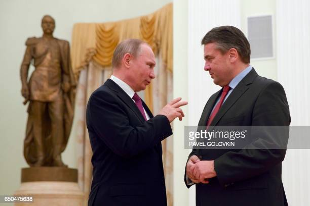 Russian President Vladimir Putin speaks with German Foreign Minister Sigmar Gabriel during their meeting at the Kremlin in Moscow on March 9 2017 /...