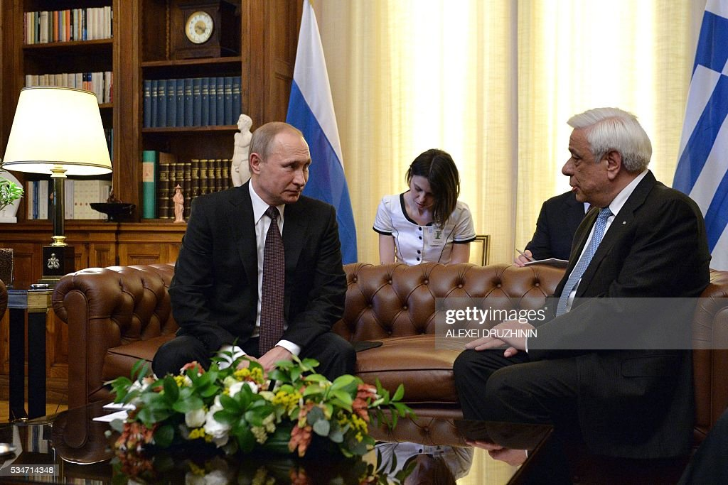 Russian President Vladimir Putin (L) speaks with Greek President Prokopios Pavlopoulos during a meeting in Athens on May 27, 2016. Russian President Vladimir Putin was in Greece on May 27 in a visit aimed at reinforcing a relationship with one of his few friends in the EU amid tensions with the West. The visit, Putin's first to the EU since December, comes at a low ebb in relations between Russia and Europe over the conflict in Ukraine that broke out in 2014, with sanctions still in force against Moscow. / AFP / SPUTNIK / Alexei Druzhinin