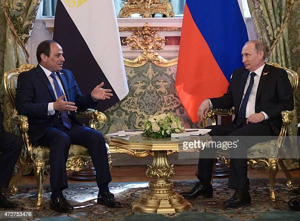 Russian President Vladimir Putin speaks with his Egyptian counterpart Abdel Fattah alSisi during a meeting at the Kremlin in Moscow following the...