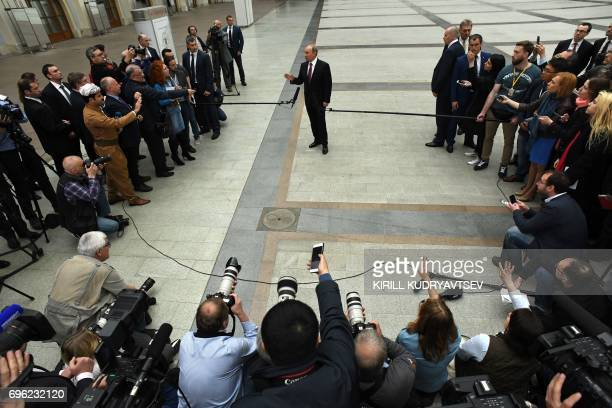 Russian President Vladimir Putin speaks with journalists after his annual 'Direct Line with Vladimir Putin broadcast live' by Russian TV channels and...