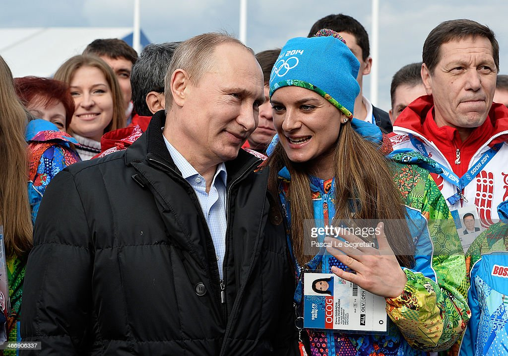 Russian President <a gi-track='captionPersonalityLinkClicked' href=/galleries/search?phrase=Vladimir+Putin&family=editorial&specificpeople=154896 ng-click='$event.stopPropagation()'>Vladimir Putin</a> speaks with Olympic Village Mayor <a gi-track='captionPersonalityLinkClicked' href=/galleries/search?phrase=Elena+Isinbaeva&family=editorial&specificpeople=3230101 ng-click='$event.stopPropagation()'>Elena Isinbaeva</a> while visiting the Coastal Cluster Olympic Village ahead of the Sochi 2014 Winter Olympics at the Athletes Village on February 5, 2014 in Sochi, Russia.