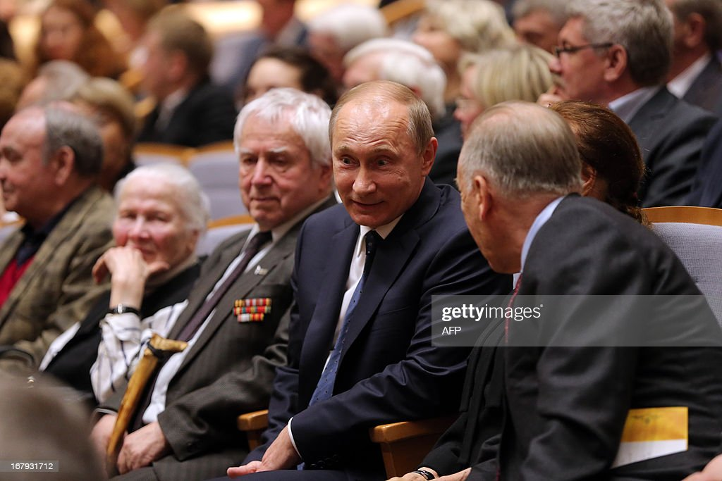 Russian President Vladimir Putin (2nd R) speaks with people during the Grand gala dedicated to the opening of the new stage Mariinsky II theatre in St. Petersburg on May 2, 2013. Russia's famous Mariinsky theatre in Saint Petersburg was to inaugurate a new ballet and opera house on May 2 in an event coinciding with the 60th birthday of its hugely ambitious and well-connected director Valery Gergiev. AFP PHOPTO / POOL / ANATOLY MALTSEV