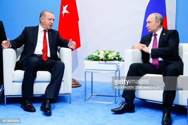Russian President Vladimir Putin speaks with Turkish President Recep Tayyip Erdogan during their meeting at the G20 summit in Hamburg on July 8 2017...