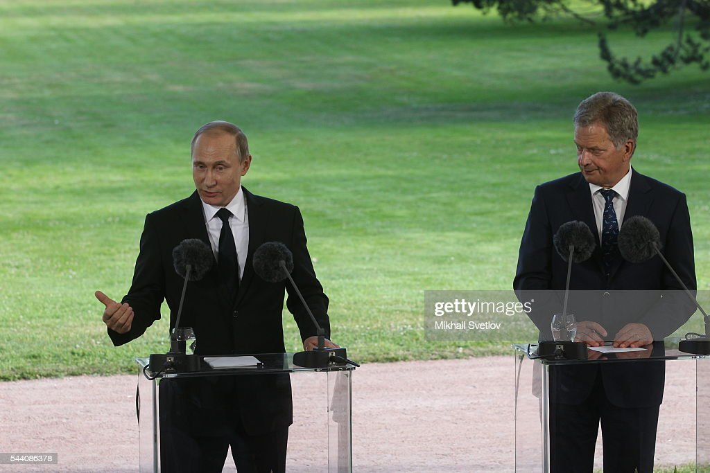 Russian President Vladimir Putin (L) speeches as Finland's President Sauli Niinisto (R) looks on during their joint press conference at the Kultaranta residence July 1, 2016 in Naantali, Finland. Putin is having a one-day visit to Finland.