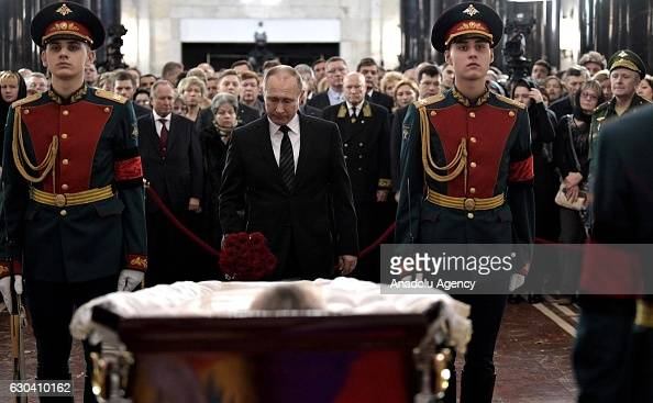 Russian President Vladimir Putin stands behind the coffin during funeral service for Russia's ambassador to Turkey Andrey Karlov in Christ the Savior...