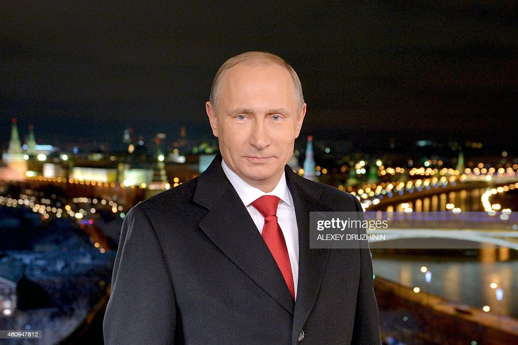 Russian President Vladimir Putin stands during a TV address to the nation on December 31 2014 in Moscow AFP PHOTO / RIA NOVOSTI / ALEXEY DRUZHININ