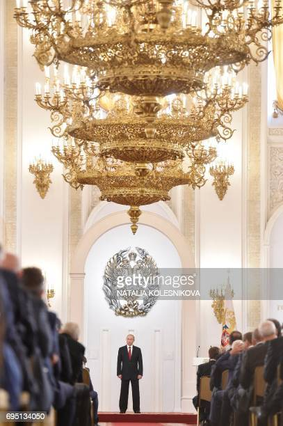 TOPSHOT Russian President Vladimir Putin stands during the State Prize awards ceremony marking the 'Day of Russia' at the Grand Kremlin Palace in...