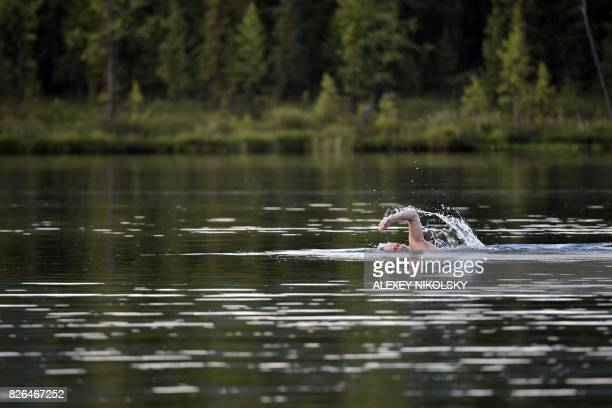 TOPSHOT Russian President Vladimir Putin swims during his vacation in the remote Tuva region in southern Siberia The picture taken between August 1...