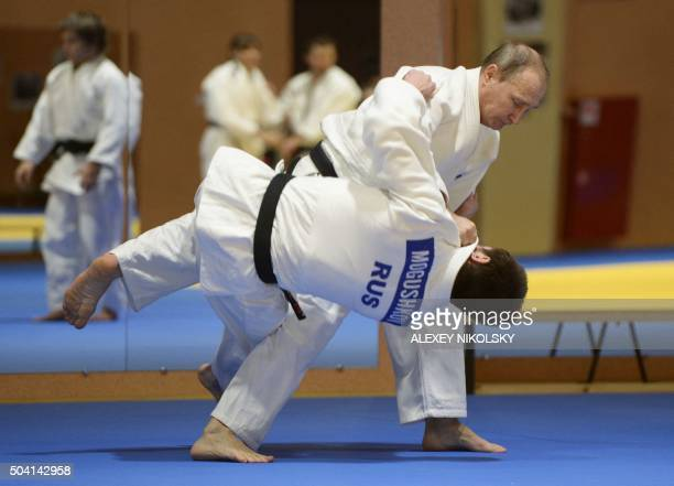 Russian President Vladimir Putin takes part in a judo training session during a meeting with Russian national judo team in Moscow on January 8 2016 /...