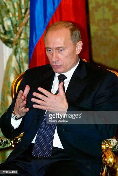 Russian President Vladimir Putin talks as he receives Syrian President Bashar Assad during their meeting in Moscow's Kremlin January 25 2005 Russia...