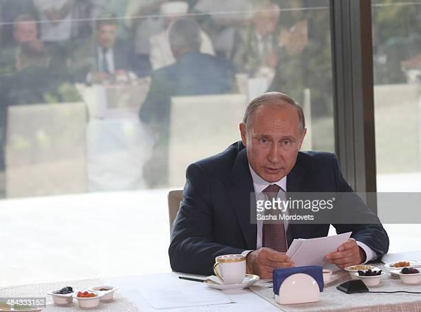 Russian President Vladimir Putin talks during his meeting with Crimean Tatars leaders and other national diasporas in Simeiz near Yalta Crimea...