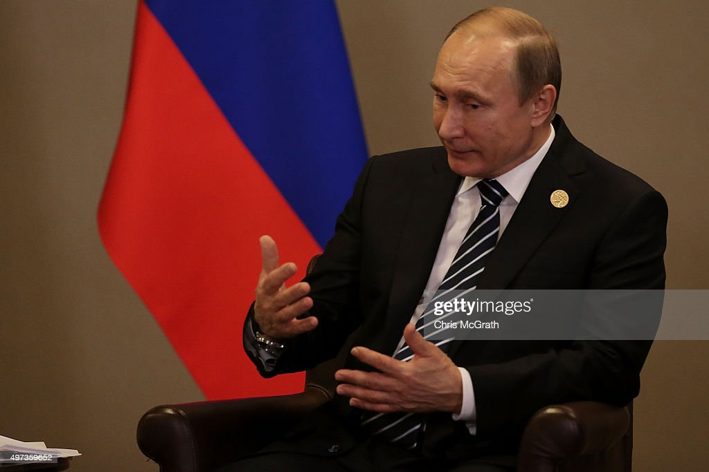 Russian President Vladimir Putin talks during the bilateral meeting with British Prime Minister David Cameron on day two of the G20 Turkey Leaders...