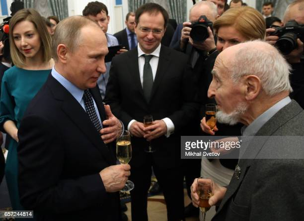 Russian President Vladimir Putin talks to animator and film director Leonid Shwartsman during the awards ceremony at the Kremlim on March 2017 in...