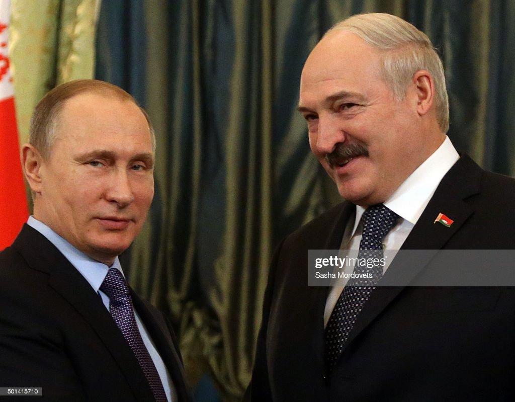 Russian President Vladimir Putin talks to Belarussian President Alexander Lukashenko during their bilateral meeting in the Grand Kremlin Palace on...