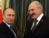 Russian President Vladimir Putin talks to Belarussian President Alexander Lukashenko during their bilateral meeting in the Grand Kremlin Palace on...