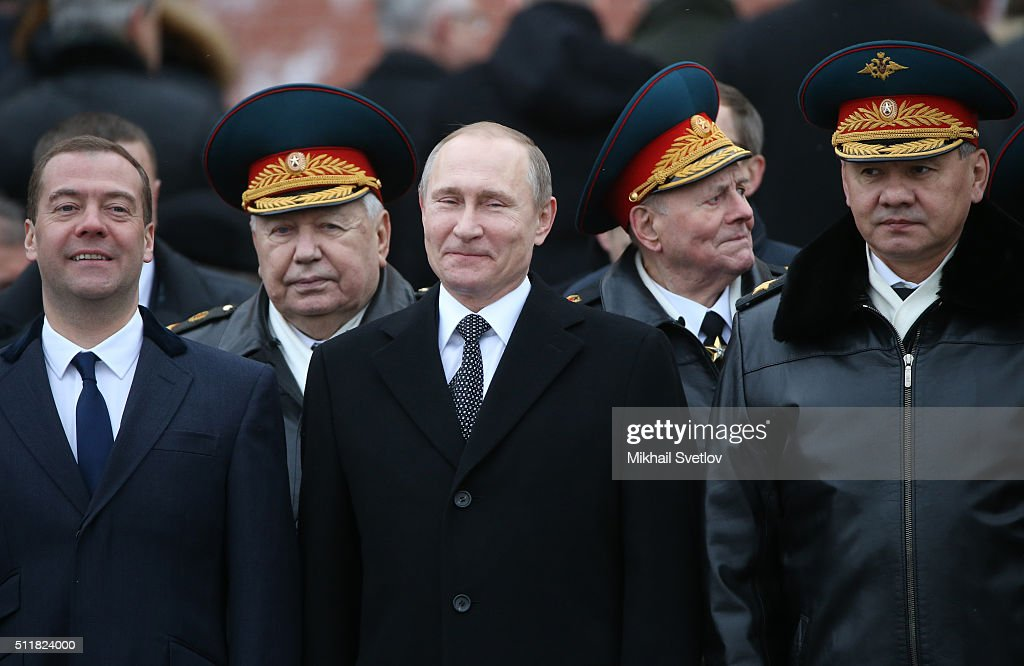 Russian President <a gi-track='captionPersonalityLinkClicked' href=/galleries/search?phrase=Vladimir+Putin&family=editorial&specificpeople=154896 ng-click='$event.stopPropagation()'>Vladimir Putin</a> (C) talks to Defence Minister Sergei Shoigu (2nd R) as Presidential Chief of Staff <a gi-track='captionPersonalityLinkClicked' href=/galleries/search?phrase=Sergei+Ivanov&family=editorial&specificpeople=220668 ng-click='$event.stopPropagation()'>Sergei Ivanov</a> (R), Prime Minister <a gi-track='captionPersonalityLinkClicked' href=/galleries/search?phrase=Dmitry+Medvedev&family=editorial&specificpeople=554704 ng-click='$event.stopPropagation()'>Dmitry Medvedev</a> (3rd L) and Council of the Federation Speaker Valentina Matviyenko (L) look on during a wreath laying ceremony at the Unknown Soldier Tomb in front of the Kremlin on February 23, 2016 in Moscow, Russia. Russia marks Defender Of The Fatherland Day today. It is also known as the Soviet Army and Navy Day.
