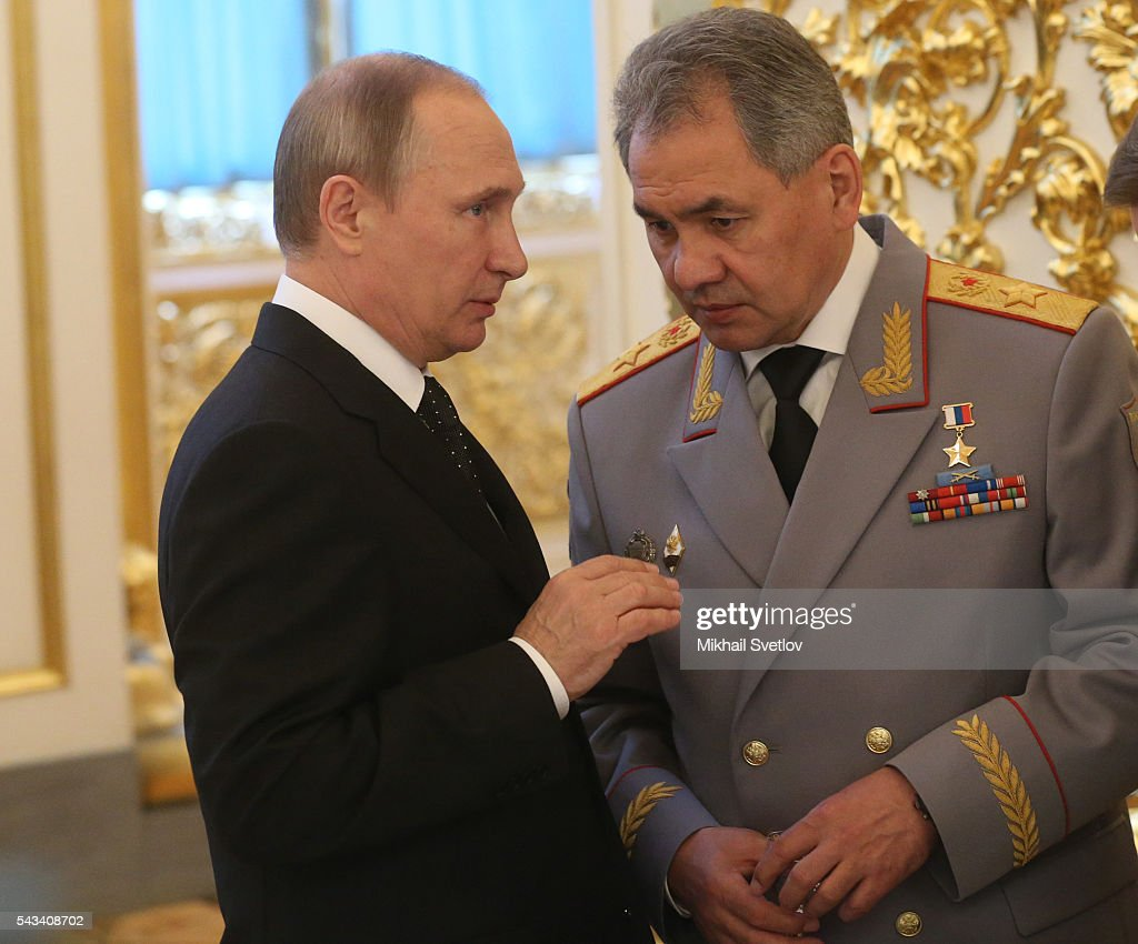 Russian President Vladimir Putin (L) talks to Defence Minister Sergei Shoigu (R) during the reception for graduates of military academies and universtities at the Grand Kremlin Palace on June 28, 2016 in Moscow, Russia.