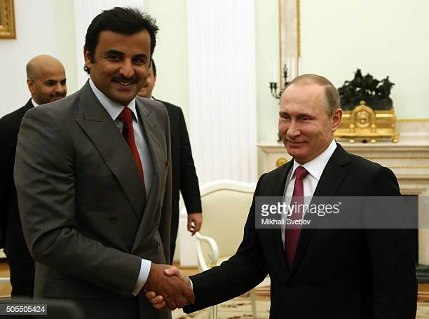 Russian President Vladimir Putin talks to Emir of the State of Qatar Sheikh Tamim bin Hamad Al Thani during their meeting at the Kremlin on January...