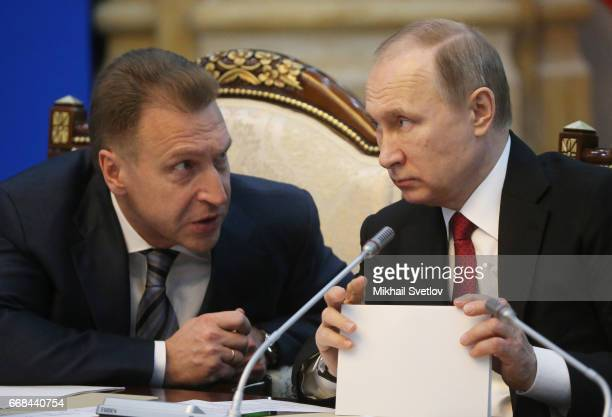 Russian President Vladimir Putin talks to First Deputy Prime Minister Igor Shuvalov during the Supreme Eurasian Economic Council of the Eurasian...