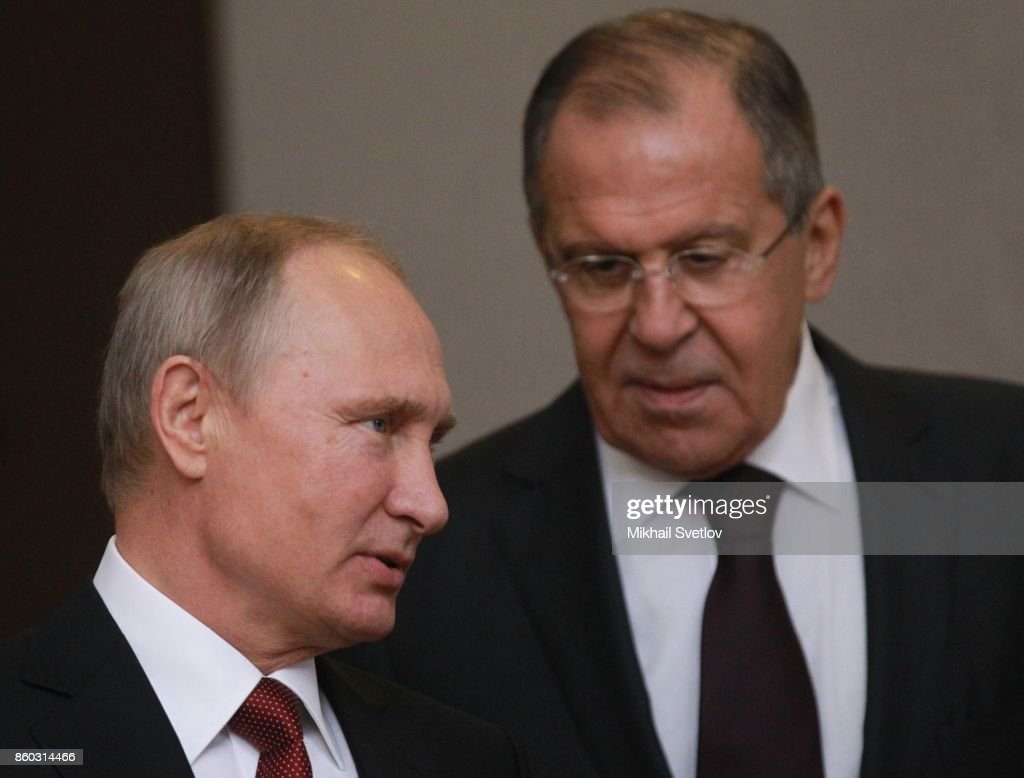 Russian President Vladimir Putin (L) talks to Foreign Minister Sergey Lavrov (R) during the Summit of CIS October 12, 2017 in Sochi, Russia. Leaders of ex-Soviet states have gathered in Sochi for the CIS and Eurasian Economic Orgahisation. Photo by Mikhail Svetlov/Getty Images)