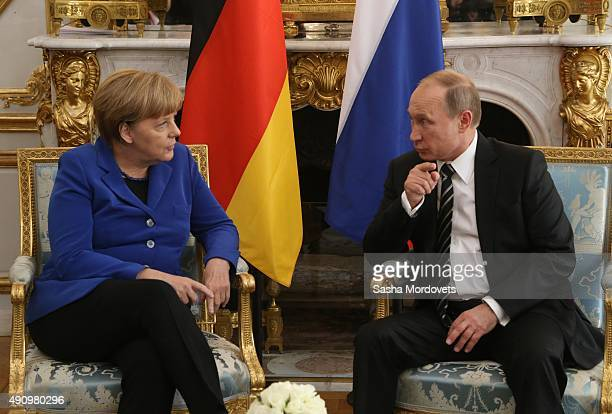 Russian President Vladimir Putin talks to German Chancellor Angela Merkel during their meeting at the Normandy Format Summit on October 02 2015 in...