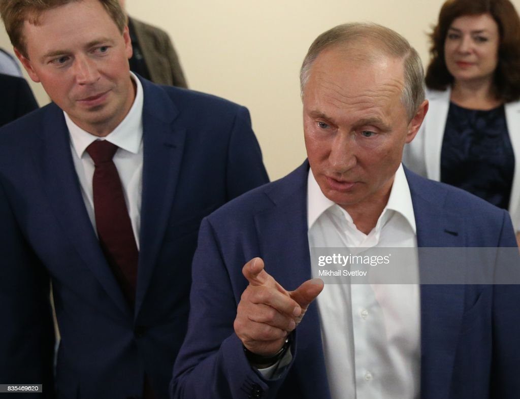Russian President Vladimir Putin (C) talks to Governor of Sevastopol Dmitry Ovsyannikov (L) while visiting a newly opened school on August 18, 2017 on Sevastopol, Crimea. Vladimir Putin is in a three day trip to the Black Sea city of Sevastopol, located in Crimean Peninsula, a disputed territory between Ukraine and Russia, annexed in 2014. Photo by Mikhail Svetlov/Getty Images)
