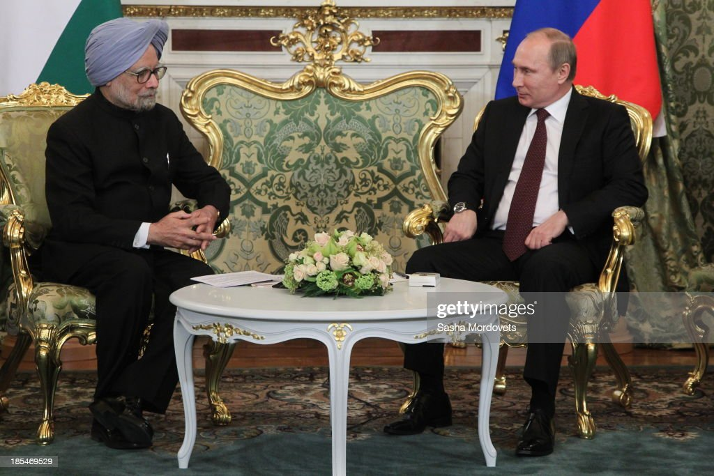 Russian President <a gi-track='captionPersonalityLinkClicked' href=/galleries/search?phrase=Vladimir+Putin&family=editorial&specificpeople=154896 ng-click='$event.stopPropagation()'>Vladimir Putin</a> (R) talks to Indian Prime Minister <a gi-track='captionPersonalityLinkClicked' href=/galleries/search?phrase=Manmohan+Singh&family=editorial&specificpeople=227120 ng-click='$event.stopPropagation()'>Manmohan Singh</a> (L) during their bilateral meeting in the Kremlin on October 21, 2013 in Moscow, Russia, Prime Minister <a gi-track='captionPersonalityLinkClicked' href=/galleries/search?phrase=Manmohan+Singh&family=editorial&specificpeople=227120 ng-click='$event.stopPropagation()'>Manmohan Singh</a> is currently on a state visit to Russia.