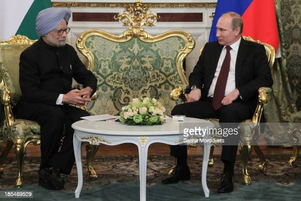 Russian President Vladimir Putin talks to Indian Prime Minister Manmohan Singh during their bilateral meeting in the Kremlin on October 21 2013 in...