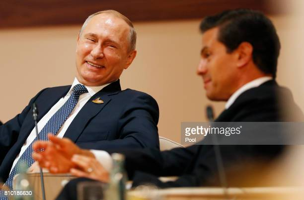 Russian President Vladimir Putin talks to Mexico President Enrique Nieto during the G20 leaders retreat as part of the G20 summit on July 7 2017 in...