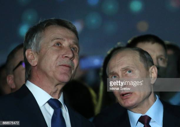 Russian President Vladimir Putin talks to Novatek CEO Leonid Michelson while visiting the LNG plant in Sabetta sea port at Yamal peninsula in Siberia...