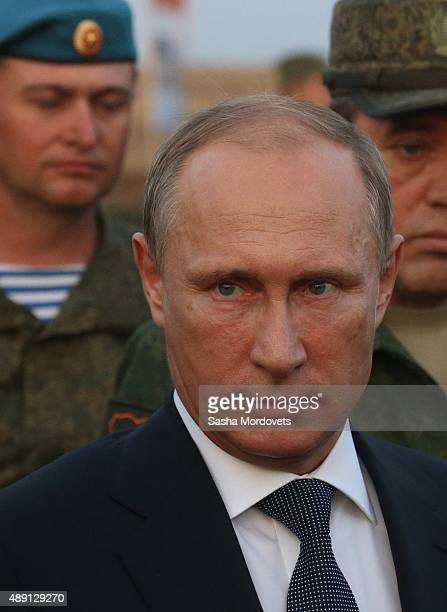 Russian President Vladimir Putin talks to officers as he attends Russias largescale Center2015 military exercises at Donguzsky Range September 19...