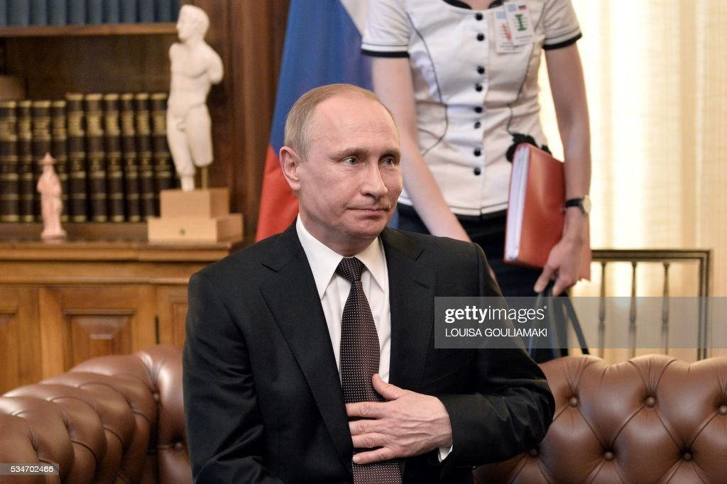 Russian President Vladimir Putin talks with his Greek counterpart Prokopis Pavlopoulos (not pictured) during their meeting at the Presidental mansion in Athens on May 27, 2016. Putin visits Greece aiming to reinforce a relationship with one of his few friends in the EU amid continuing diplomatic tensions with the West. The visit -- Putin's first to the EU since December -- comes as the bloc's leaders are to discuss next month whether to renew sanctions on Russia's banking, defence and energy sectors that expire in July. / AFP / POOL / LOUISA
