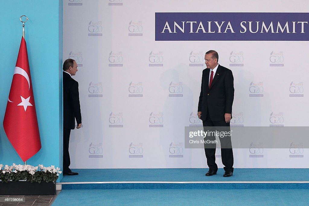 Russian President, <a gi-track='captionPersonalityLinkClicked' href=/galleries/search?phrase=Vladimir+Putin&family=editorial&specificpeople=154896 ng-click='$event.stopPropagation()'>Vladimir Putin</a>, (L) talks with Turkish President <a gi-track='captionPersonalityLinkClicked' href=/galleries/search?phrase=Recep+Tayyip+Erdogan&family=editorial&specificpeople=213890 ng-click='$event.stopPropagation()'>Recep Tayyip Erdogan</a>, before leaving the arrival area during the official welcome ceremony on day one of the G20 Turkey Leaders Summit on November 15, 2015 in Antalya, Turkey. World leaders will use the summit to discuss issues including, climate change, the global economy, the refugee crisis and terrorism. The two day summit takes place in the wake of the massive terrorist attack in Paris which killed more than 120 people.