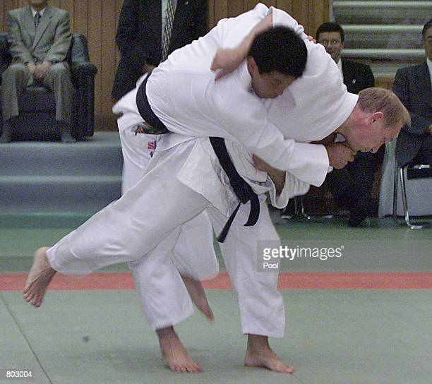 Russian President Vladimir Putin throws a Japanese judo expert during a judo exercise at Kodokan September 5 2000 in Tokyo For the second time in...