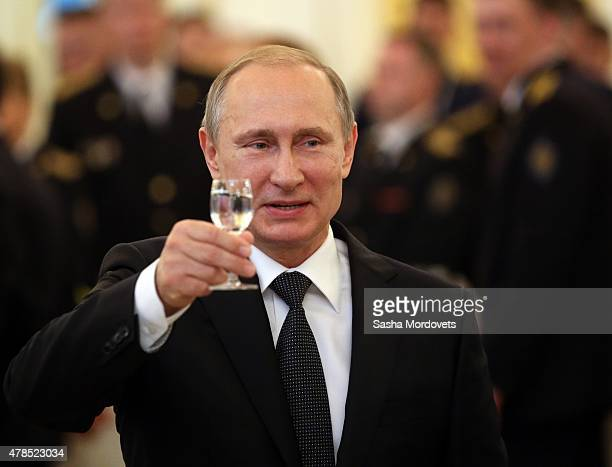 Russian President Vladimir Putin toasts during reception for graduated of military academies in the Grand Kremlin Palace on June 25 2015 in Moscow...