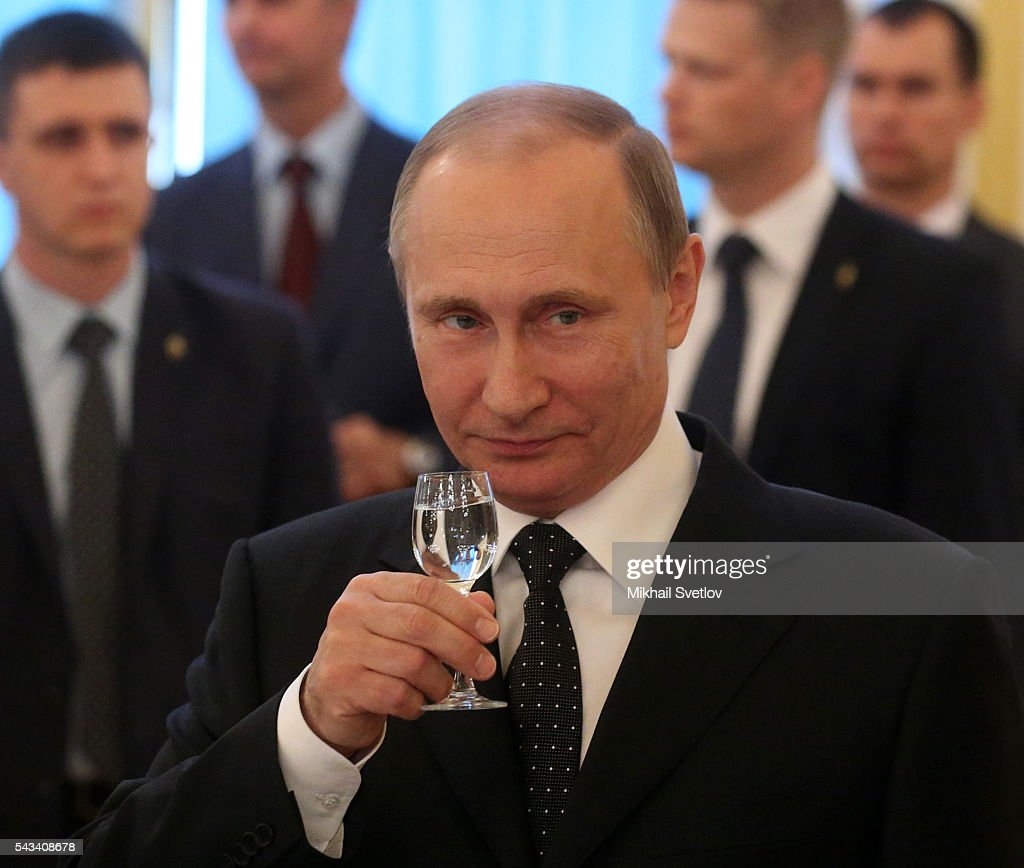Russian President Vladimir Putin toasts holding a glass of vodka during the reception for graduates of military academies and universtities at the Grand Kremlin Palace on June 28, 2016 in Moscow, Russia.