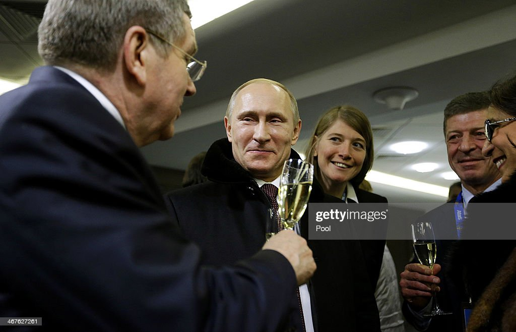 Russian President Vladimir Putin (2nd L) toasts International Olympic Committee President Thomas Bach (L) in the presidential lounge after the opening ceremony of the Sochi 2014 Winter Olympics at the Fisht Olympic Stadium on February 7, 2014, in Sochi, Russia.