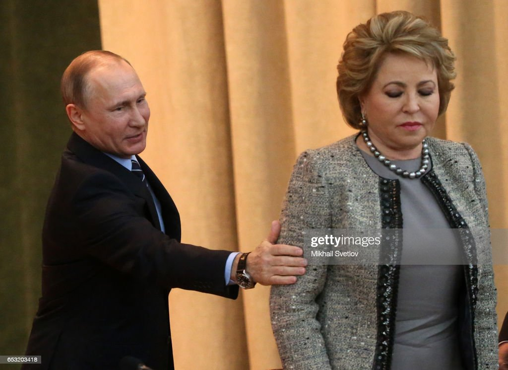 Russian President Vladimir Putin (L) touches Council of the Federation Speaker Valentina Natviyenko (R) during the Prosecutor General's Annual Board on March 14, 2017 in Moscow, Russia.