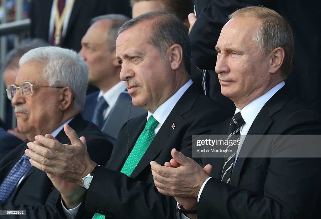 Russian President Vladimir Putin Turkish President Tayyip Erdogan and Palestine's President Mahmoud Abbas attend an opening ceremony for the newly...