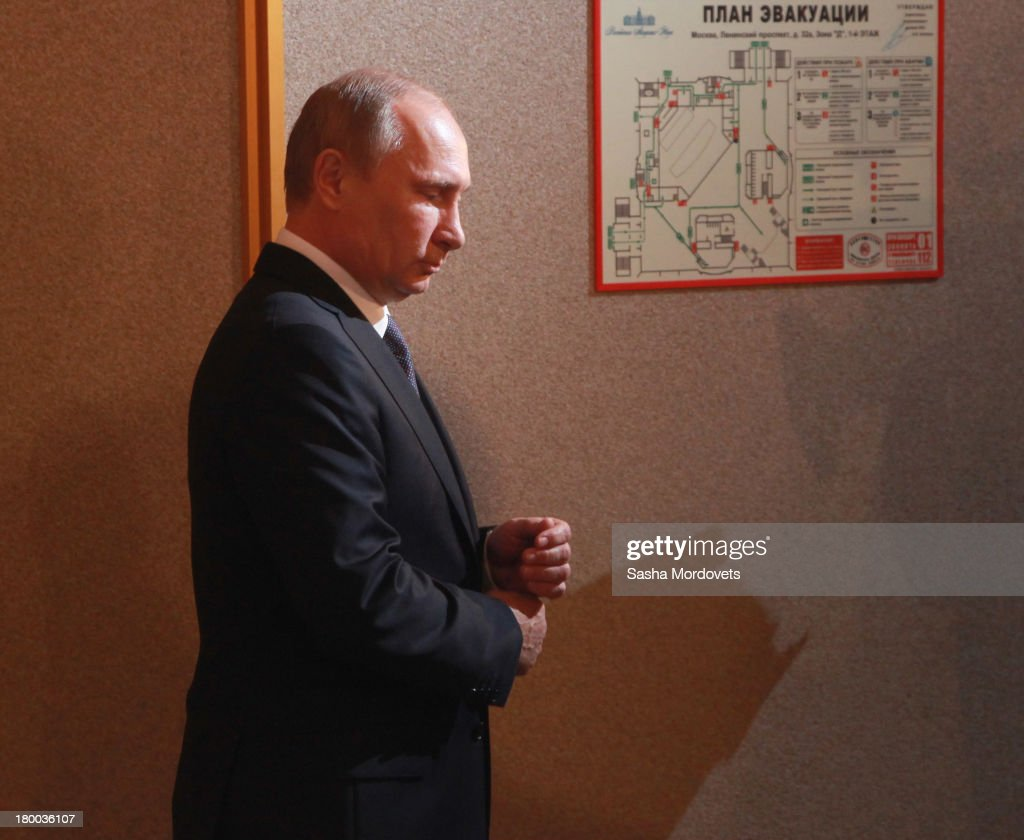 Russian President <a gi-track='captionPersonalityLinkClicked' href=/galleries/search?phrase=Vladimir+Putin&family=editorial&specificpeople=154896 ng-click='$event.stopPropagation()'>Vladimir Putin</a> visits a polling station for mayoral elections on September 08, 2013 in Moscow, Russia. Opposition leader Alexey Navalny, one of Putin's most vocal critics is a candidate for mayor in Moscow.