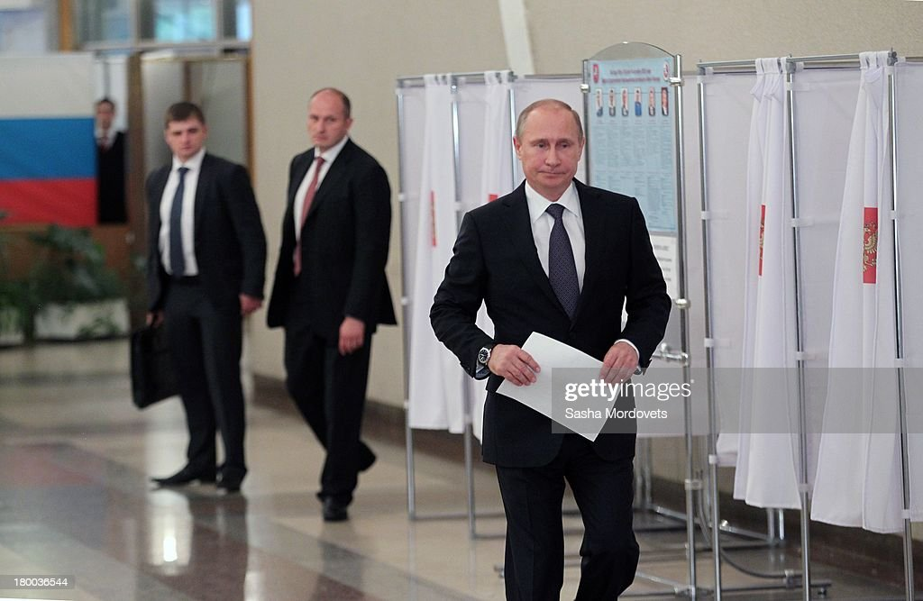 Russian President <a gi-track='captionPersonalityLinkClicked' href=/galleries/search?phrase=Vladimir+Putin&family=editorial&specificpeople=154896 ng-click='$event.stopPropagation()'>Vladimir Putin</a> visits a polling station to vote for the mayoral elections on September 08, 2013 in Moscow, Russia. Opposition leader Alexey Navalny, one of Putin's most vocal critics is a candidate for mayor in Moscow.