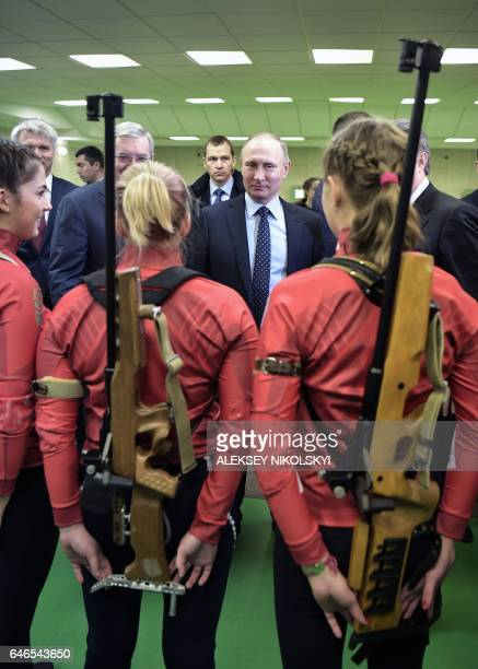 Russian President Vladimir Putin visits the Academy of Biathlon in Krasnoyarsk on March 1 2017 / AFP / SPUTNIK / Aleksey NIKOLSKYI